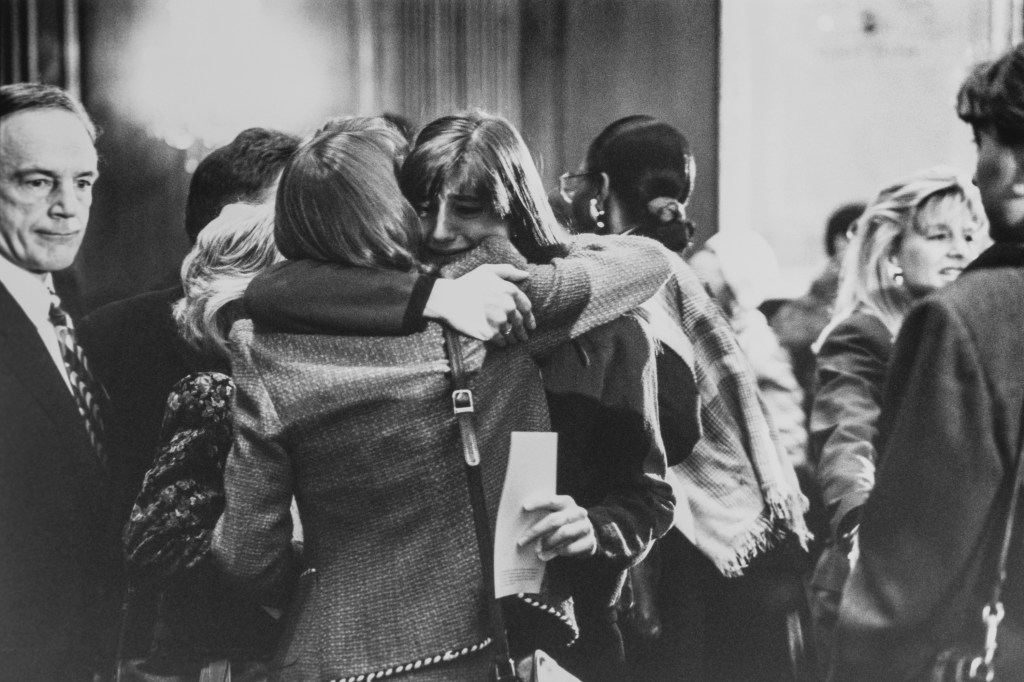 Sen. J. Bennett Johnston, D-La., Elizabeth Gardener, Legislative Assistant to Sen. Howell Heflin, friend and co-workers of Tom Barnes embraces Hope Green, LC to Sen. Richard Shelby after service. Lots of teary eyes during Tom Barnes memorial on Jan. 23, 1992. (Photo by Laura Patterson/CQ Roll Call via Getty Images)