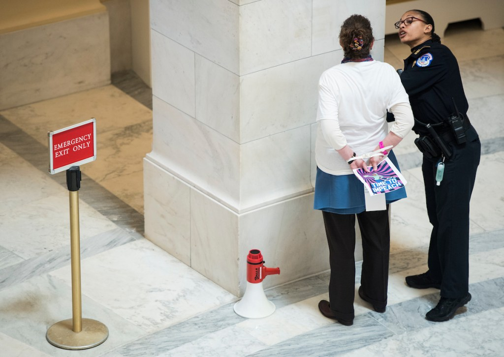 About 20 protesters were arrested while gathered to occupy the rotunda to call for the House to initiate Impeachment hearings. (Photo By Bill Clark/CQ Roll Call)