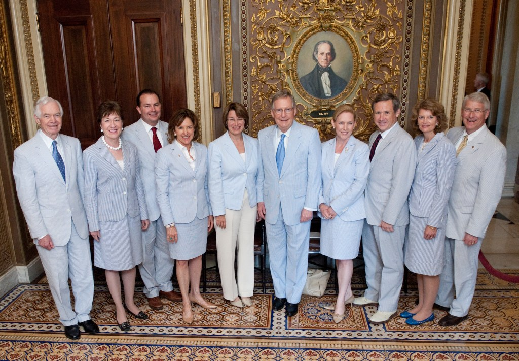 UNITED STATES - JUNE 23: Senators wearing seersucker suits pose for a group photo in the Senate Reception Room in the Capitol on Thursday, June 23, 2011. From left are Senators Thad Cochran, Susan Collins, Mike Lee, Kay Hagan, Amy Klobuchar, Mitch McConnell, Kirsten Gillibrand, Mark Kirk, Lisa Murkowski, and Roger Wicker. The third thursday of June is traditionally called Seersucker Thursday. (Photo By Bill Clark/Roll Call)