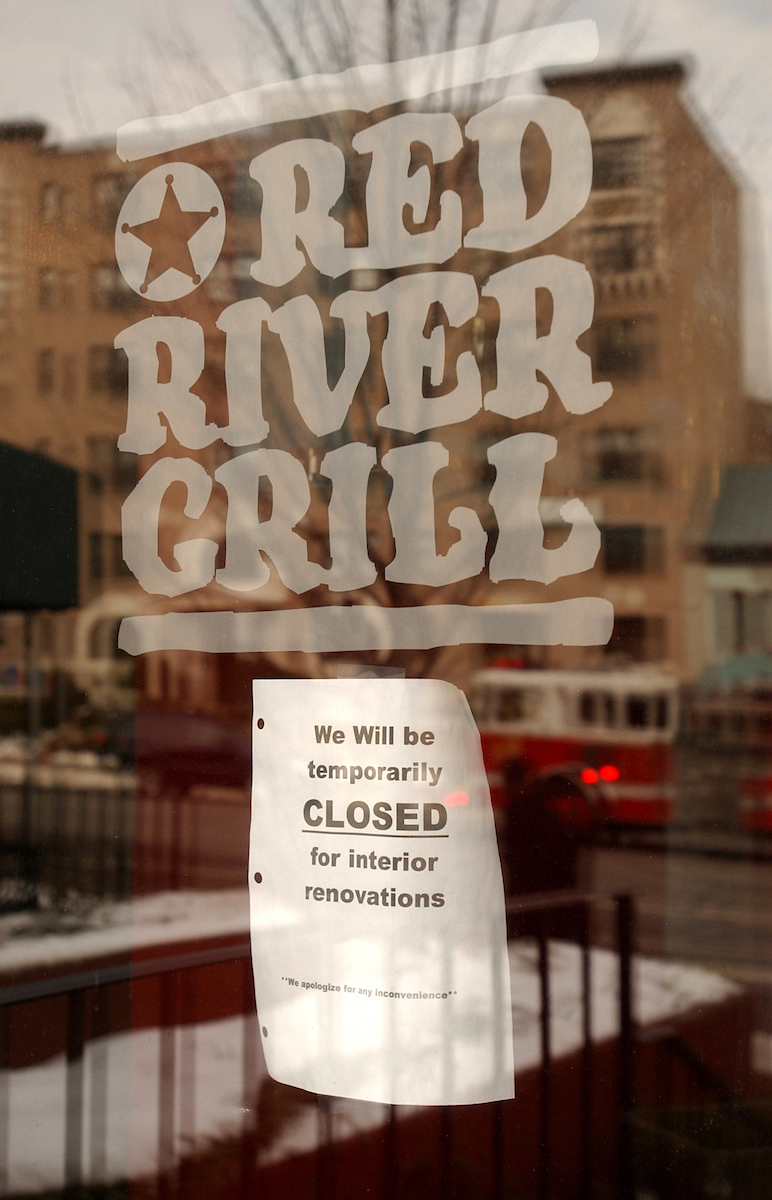 Sign on the door of Red River Grill