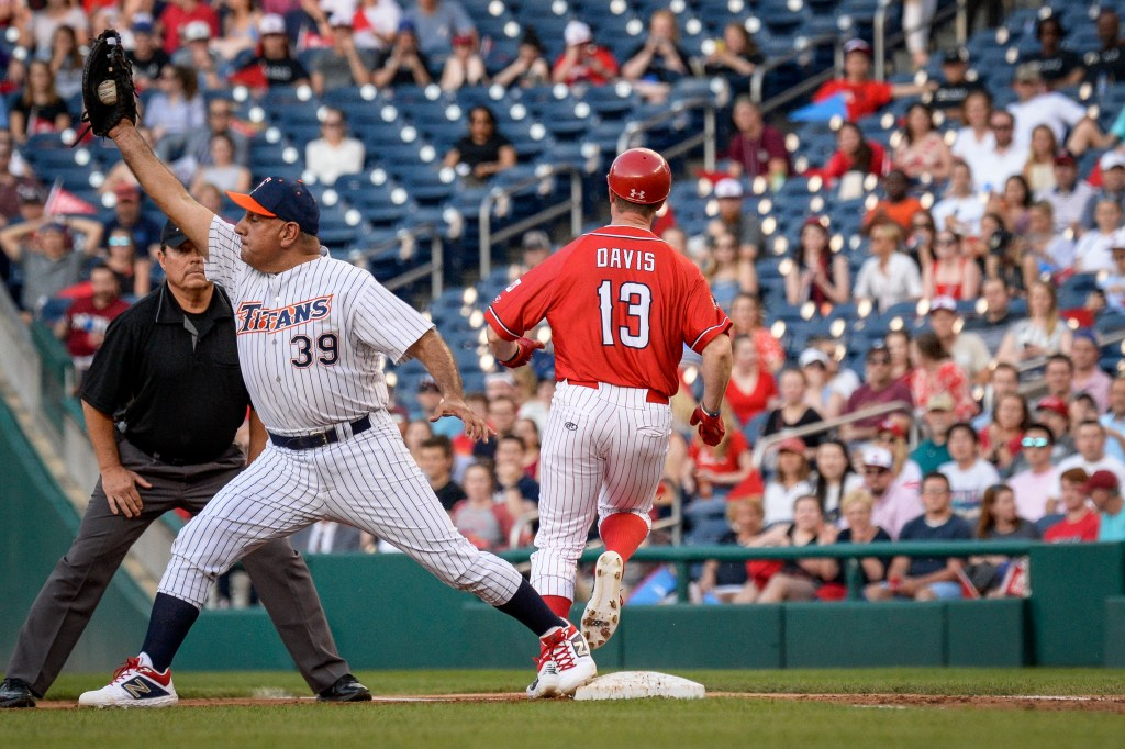 UNITED STATES - JUNE 26: Rep. Gil Cisneros, D-Calif., catches the ball as Rep. Rodney Davis, R-Ill., runs safely into first base in the 58th annual Congressional Baseball Game at Nationals Park on Wednesday June 26, 2019. (Photo by Caroline Brehman/CQ Roll Call)