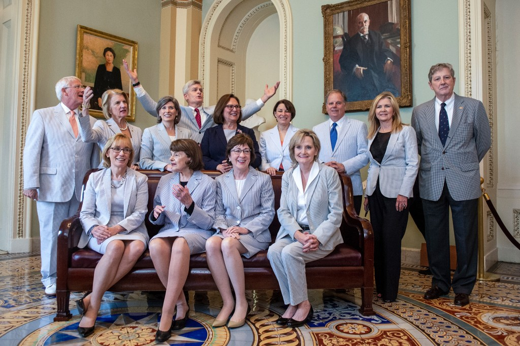 UNITED STATES - JUNE 13: Sen. Maggie Hassan, D-N.H., front left, Sen. Dianne Feinstein, D-Calf., Sen. Susan Collins, R-Maine, Sen. Cindy Hyde-Smith, R-Miss., Sen. Roger Wicker, R-Miss., back left, Sen. Shelley Moore Capito, R-W.Va., Sen. Joni Ernst, R-Iowa, Sen. Bill Cassidy, R-La., Sen. Deb Fischer, R-Neb., Sen. Amy Klobuchar, D-Minn., Sen. Doug Jones, D-Ala., R-N.C., Sen. Marsha Blackburn, R-Tenn., and Sen. John Kennedy, R-La., come together to celebrate National Seersucker Day in Washington on Thursday June 13, 2019. (Photo by Caroline Brehman/CQ Roll Call)