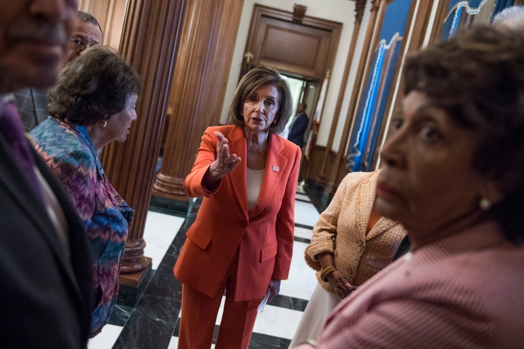 UNITED STATES - JUNE 5: Speaker Nancy Pelosi, D-Calif., talks with members in the Capitol before a bill signing for the