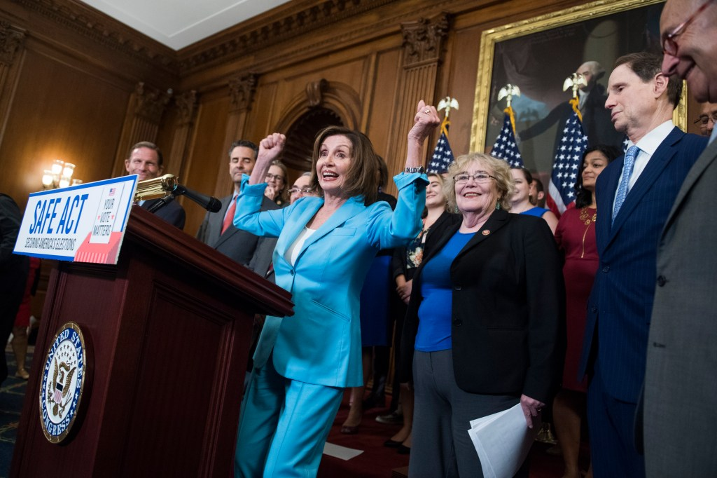 """UNITED STATES - JUNE 26: Speaker Nancy Pelosi, D-Calif., and Senate Minority Leader Charles Schumer, D-N.Y., far right, are seen at an event with House and Senate Democrats in the Capitol before a House vote on the """"Securing America's Federal Elections (SAFE) Act of 2019,"""" on Wednesday, June 26, 2019. (Photo By Tom Williams/CQ Roll Call)"""