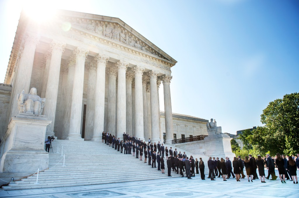 UNITED STATES - JULY 22: Pallbearers carry the casket containing former Supreme Court Justice John Paul Stevens in front the U.S. Supreme Court in Washington on Monday July 22, 2019. (Photo by Caroline Brehman/CQ Roll Call)
