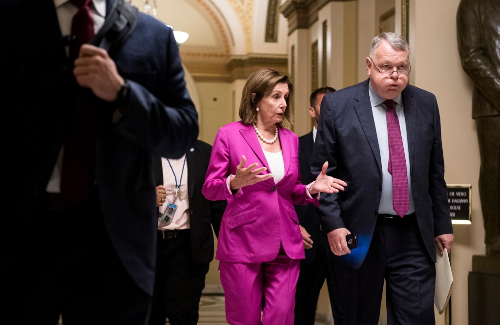 UNITED STATES - JULY 16: Speaker of the House Nancy Pelosi, D-Calif., speaks with senior advisor Wendell Primus as she leaves the House floor after the House voted against striking the Speaker's words from the record on Tuesday, July 16, 2019. (Photo By Bill Clark/CQ Roll Call)