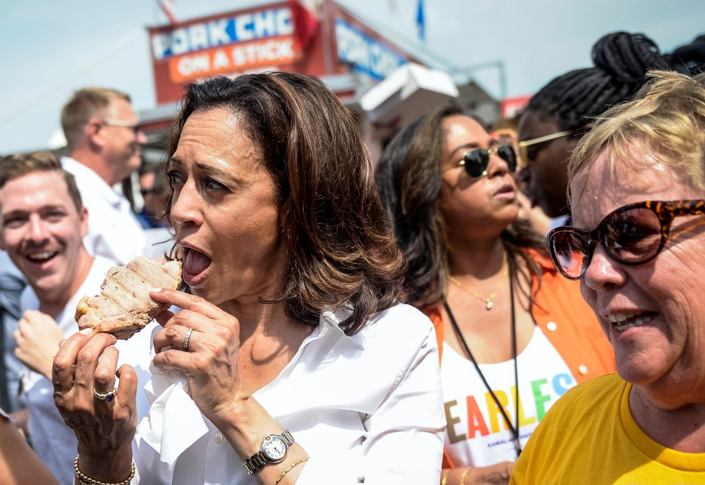 UNITED STATES - AUGUST 10: Democratic presidential candidate Sen. Kamala Harris, D-Calif., takes a bite of a pork chop at the Iowa State Fair on Saturday August 10, 2019. (Photo by Caroline Brehman/CQ Roll Call)