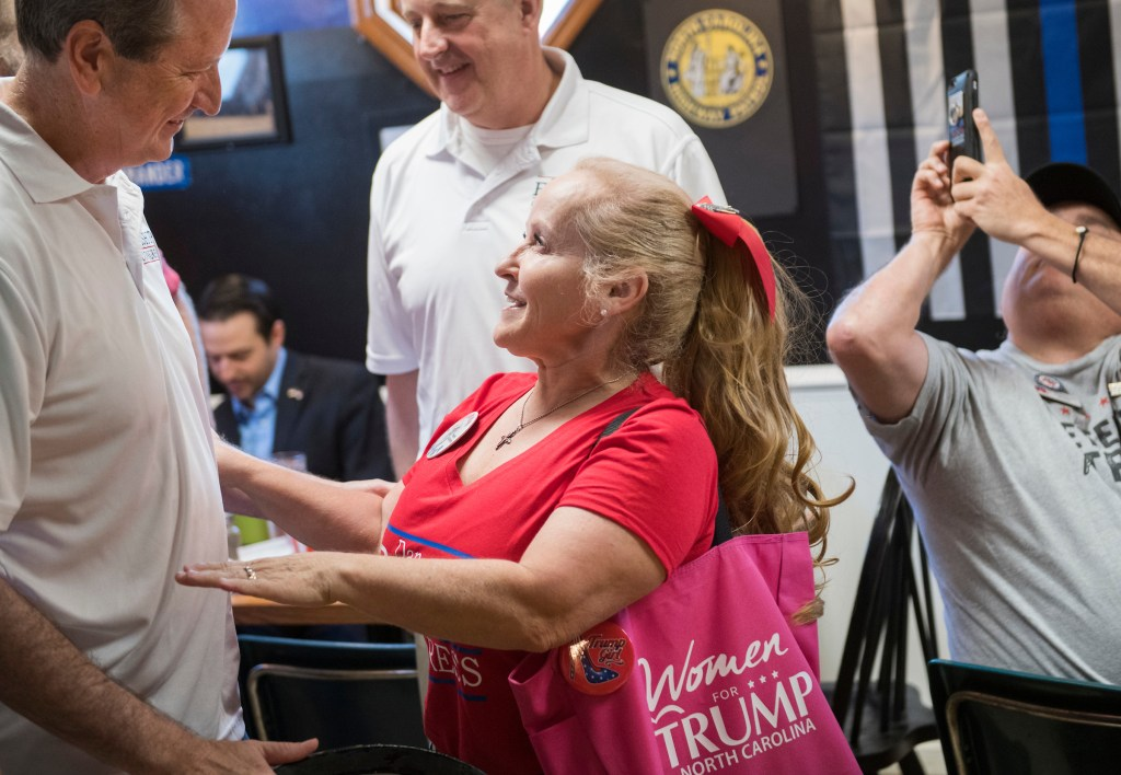 UNITED STATES - AUGUST 10: Dan Bishop, Republican candidate for North Carolina's 9th District, talks with Sherry Lynn Womack at Robin's On Main diner in Hope Mills, N.C., on Saturday, August 10, 2019. (Photo By Tom Williams/CQ Roll Call) y
