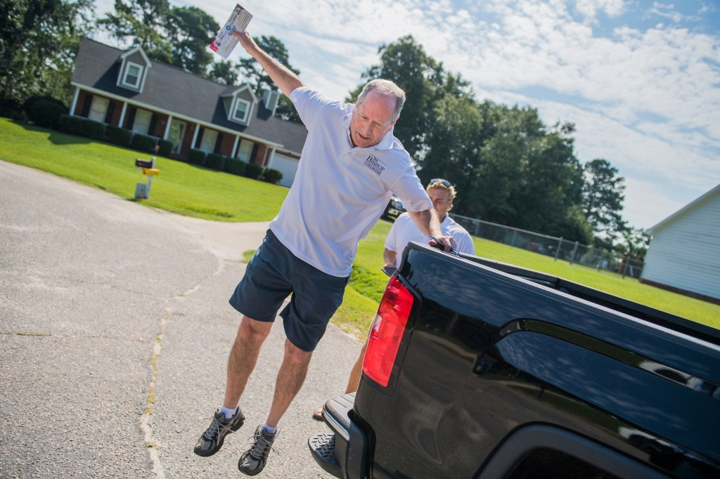 UNITED STATES - AUGUST 10: Dan Bishop, Republican candidate for North Carolina's 9th District, hops off a truck while canvassing a neighborhood in Parkton, N.C., on Saturday, August 10, 2019. (Photo By Tom Williams/CQ Roll Call)