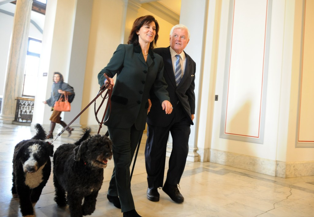 Sen. Ted Kennedy, D-Mass., walks with his wife Victoria and his dogs Sunny and Splash to a celebration honoring his return to the Senate after he had been away recovering from brain surgery, November 17, 2008.