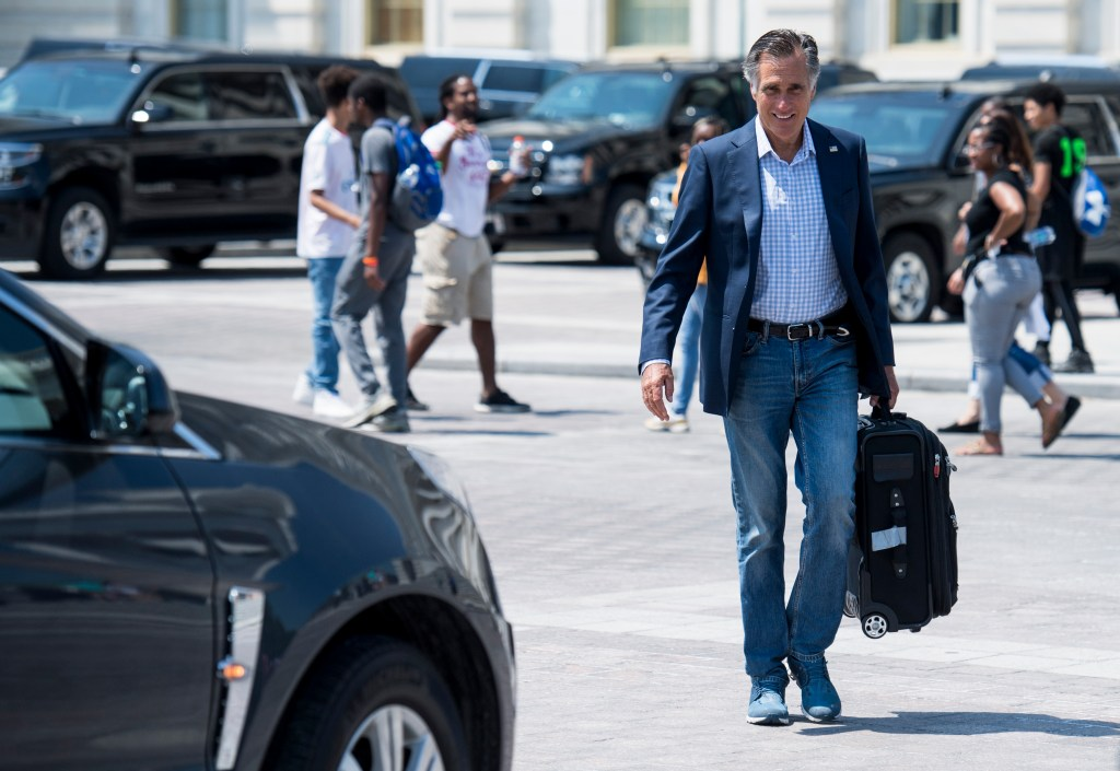 UNITED STATES - AUGUST 1: Sen. Mitt Romney, R-Utah, leaves the Capitol for August recess with his roller bag after the final vote on a two-year budget and debt ceiling deal on Thursday, August 1, 2019. (Photo By Bill Clark/CQ Roll Call)