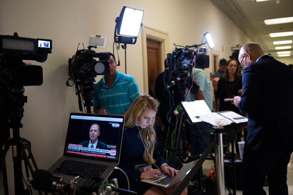 UNITED STATES - SEPTEMBER 26: The media gathers in the hallway outside of the House Intelligence Committee hearing room as Acting Director of National Intelligence Joseph Maguire testifies before the committee on the Capitol on Thursday, Sept. 26, 2019. (Photo by Caroline Brehman/CQ Roll Call)