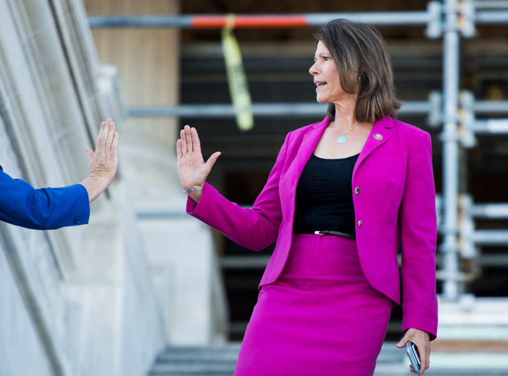UNITED STATES - SEPTEMBER 19: Rep. Cheri Bustos, D-Ill., right, gets a high five from Rep. Katie Porter, D-Calif., as she walks down the House steps at the Capitol after a vote on Thursday, Sept. 19, 2019. (Photo By Bill Clark/CQ Roll Call)