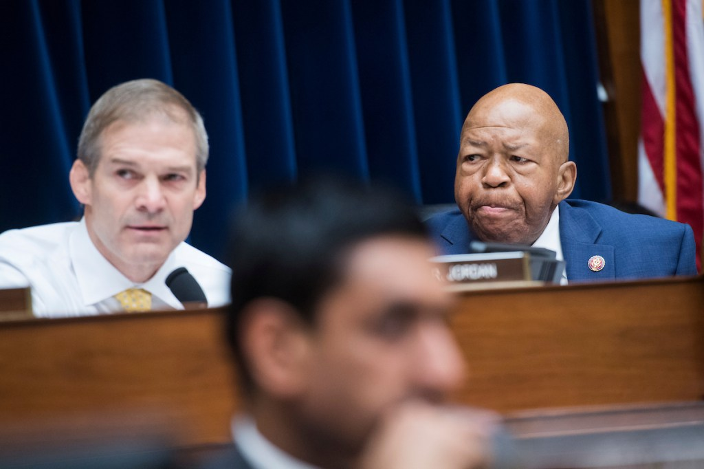 UNITED STATES - JUNE 12: Chairman Elijah Cummings, D-Md., right, and ranking member Rep. Jim Jordan, R-Ohio, conduct a House Oversight and Reform Committee markup in Rayburn Building on a resolution on whether to hold Attorney General William Barr and the Secretary of Commerce Wilbur Ross in contempt of Congress on Wednesday, June 12, 2019. (Photo By Tom Williams/CQ Roll Call)