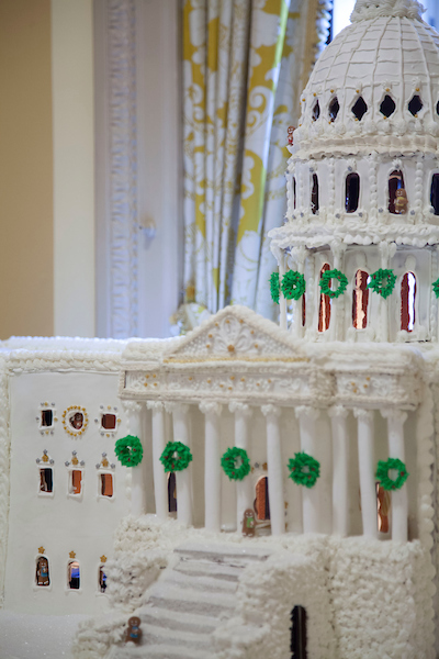 UNITED STATES - NOVEMBER 28. A gingerbread model of the Capitol Buildings displayed outside of the members only dining room in the United States Capitol. (Photo by Margaret Spencer/CQ Roll Call)