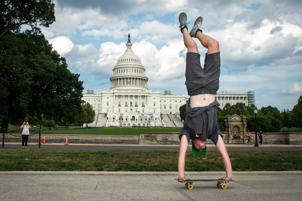 UNITED STATES - SEPTEMBER 4: A man skateboards outside of Capitol Hill in Washington on Wednesday September 4, 2019. (Photo by Caroline Brehman/CQ Roll Call)