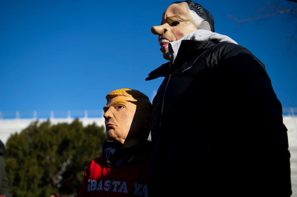 UNITED STATES - DECEMBER 18: People rally in support of the impeachment of President Donald Trump in front of the Capitol as the House of Representatives begins debate on the articles of impeachment against President Donald Trump on Wednesday Dec. 18, 2019. (Photo by Caroline Brehman/CQ Roll Call)