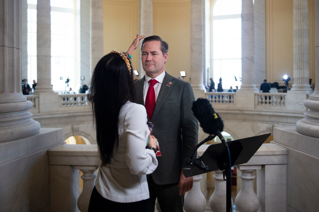 UNITED STATES - DECEMBER 18: Rep. Michael Waltz, R-Fla., has his hair fixed by a staff before being interviewed on-camera in the Cannon rotunda as House of Representatives takes up articles of impeachment against President Donald Trump in the Capitol on Wednesday Dec. 18, 2019. (Photo by Caroline Brehman/CQ Roll Call)