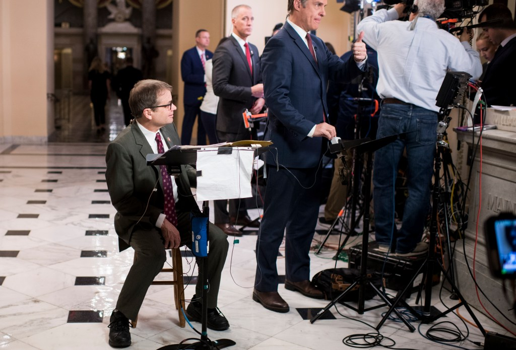 UNITED STATES - DECEMBER 10: Rep. Mike Quigley, D-Ill., sits on a stoll waiting to do a television interview in the Will Rogers Corridor of the Capitol after articles of impeachment against President Donald Trump were announced on Tuesday, Dec. 10, 2019. (Photo By Bill Clark/CQ Roll Call)