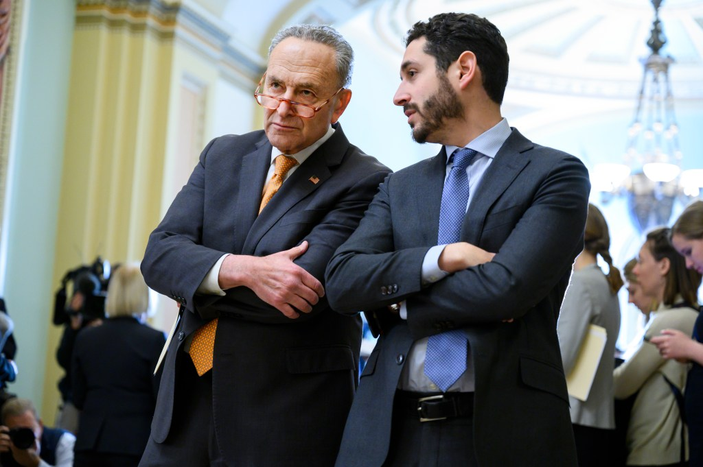UNITED STATES - December 3: Senate Minority Leader Charles Schumer, D-N.Y., and aide Justin Goodman, are seen after the Senate luncheons in the Capitol on Tuesday, December 3, 2019. (Photo By Tom Williams)