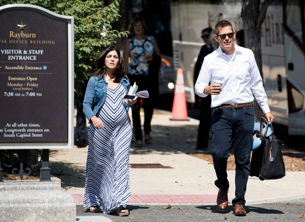 UNITED STATES - SEPTEMBER 12: Rep. Sean Duffy, R-Wisc., and his wife Rachel Campos-Duffy board a bus outside the Rayburn House Office Building at the Capitol as House Republicans prepare to head to their retreat in Baltimore on Thursday, Sept. 12, 2019. (Photo By Bill Clark/CQ Roll Call)