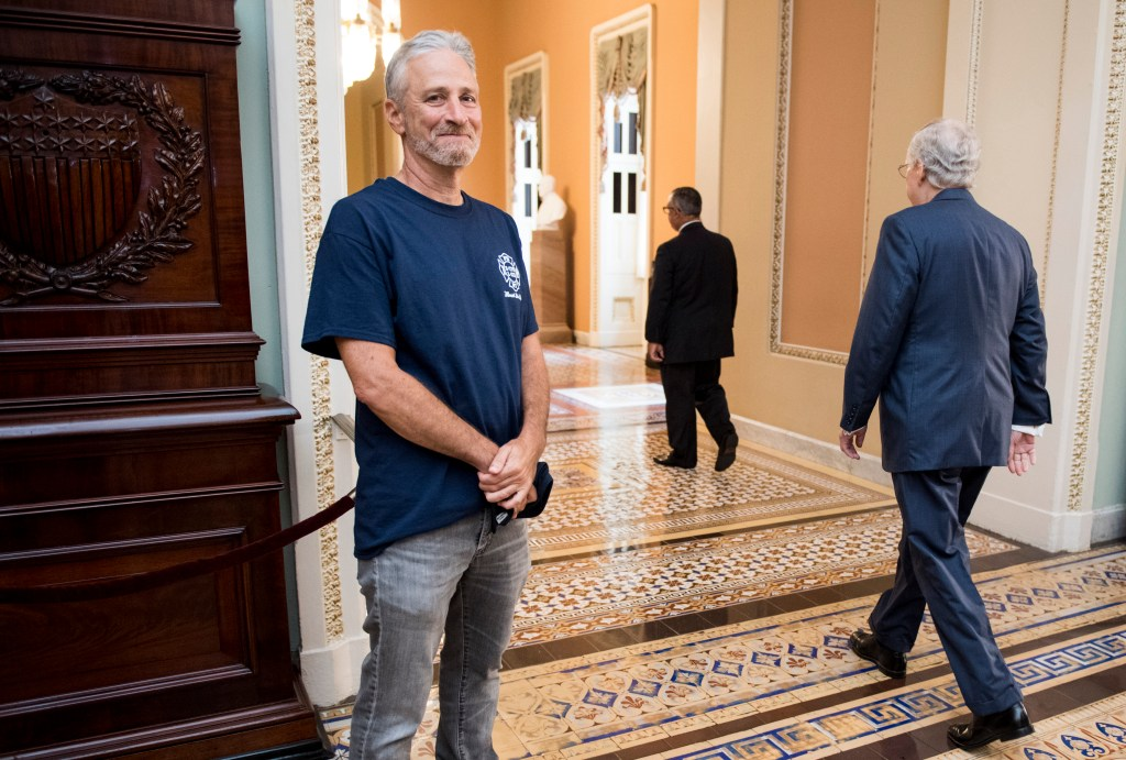 UNITED STATES - JULY 23: Jon Stewart, former host of The Daily Show, smiles as Senate Majority Leader Mitch McConnell, R-Ky., walks by at the Ohio Clock Corridor in the Capitol on Tuesday, July 23, 2019. The Senate will be voting later today on HR 1327: Never Forget the Heroes: Permanent Authorization of the September 11th Victim Compensation Fund Act. (Photo By Bill Clark/CQ Roll Call)