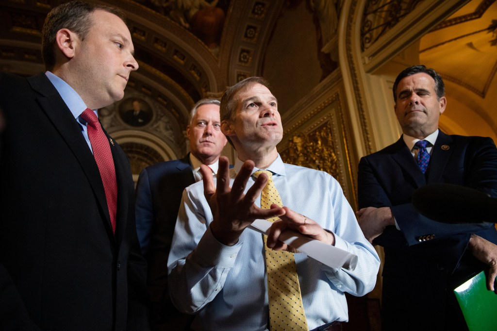 UNITED STATES - JANUARY 22: Rep. Jim Jordan, R-Ohio, center, talks to the press with Reps. Lee Zeldin, R-N.Y., left, Mark Meadows R-N.C, and John Ratcliffe, R-Texas, during a break in the Senate impeachment trial of President Donald Trump in the Senate Reception Room on Wednesday, Jan. 22, 2020. (Photo by Caroline Brehman/CQ Roll Call)