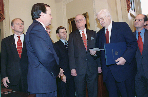 12/19/98.IMPEACHMENT VOTE-- House Judiciary Chairman Henry Hyde, R-Ill., delivers the Articles of Impeachment against President Bill Clinton just passed on the House floor to Secretary of the Senate Gary Sisco. Looking on are committee members Steve Chabot, R-Ohio, Bob Barr, R-Ga., Bill McCollum, R-Fla., James Sensenbrenner Jr., R-Wis., Charles Canady, R-Fla..CONGRESSIONAL QUARTERLY PHOTO BY SCOTT J. FERRELL