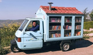 Antonio La Cava in his book mobile and library.