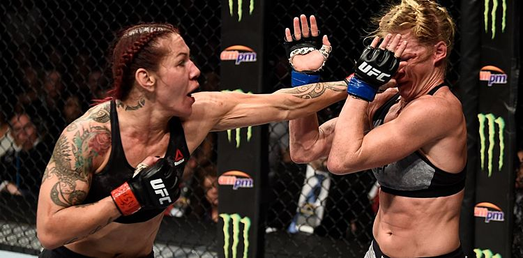 https://i1.wp.com/cdn.mmaweekly.com/wp-content/uploads/2017/12/Cris-Cyborg-punches-Holly-Holm-to-cage-UFC-219-UFC-photo.jpg?w=1060&ssl=1