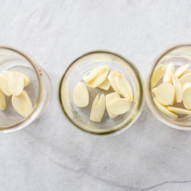 3 jars with garlic