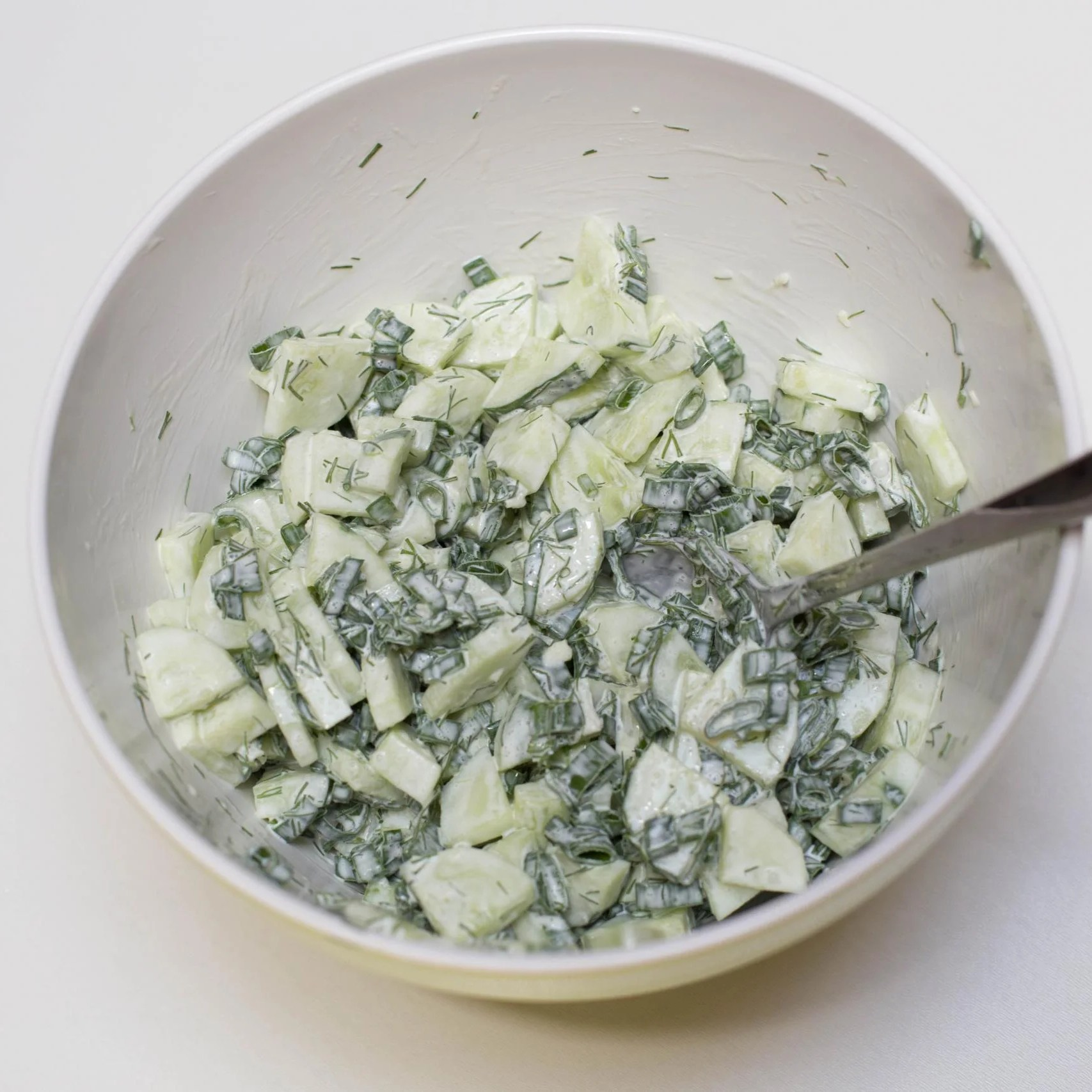 Creamy Cucumber Salad in a large mixing bowl
