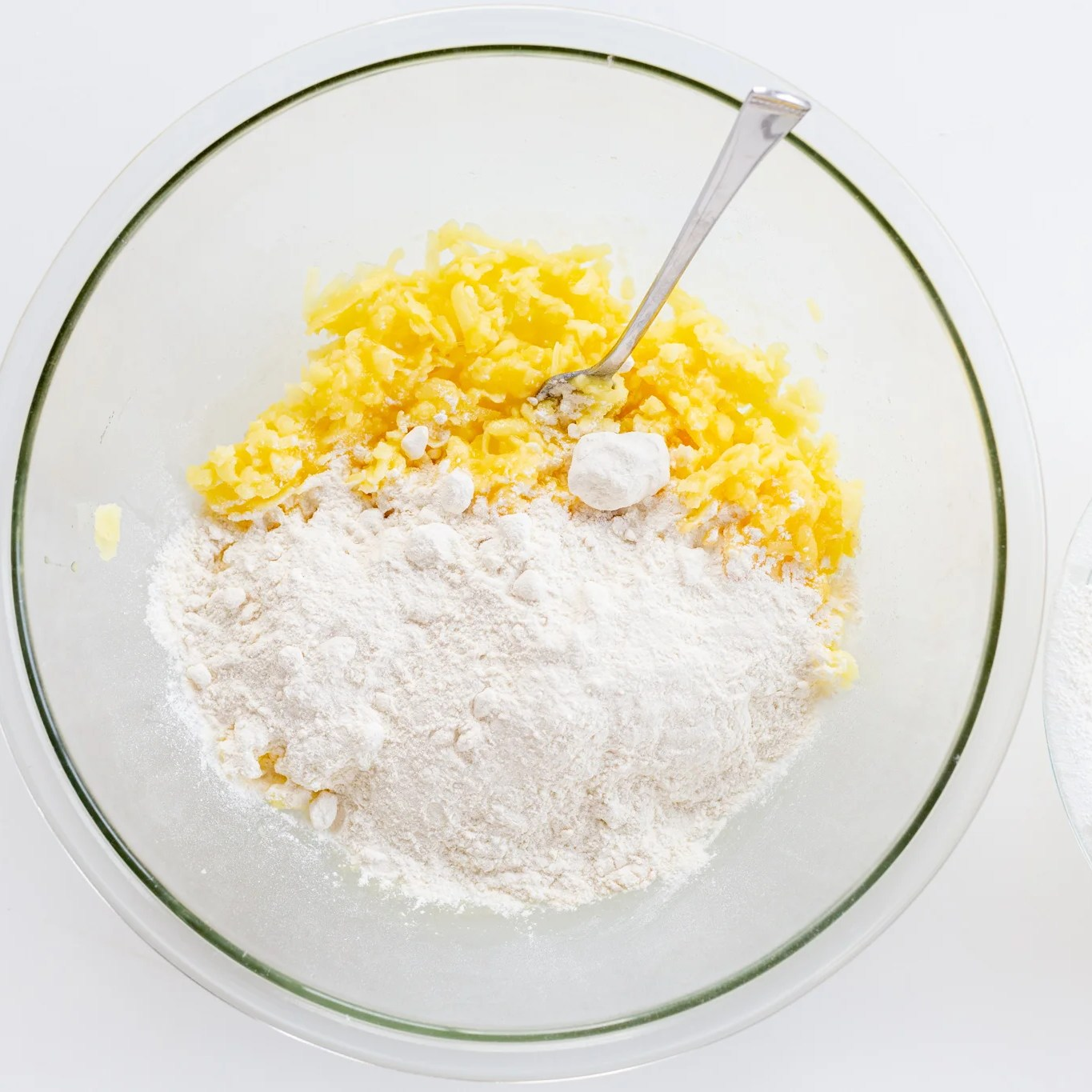 Flour added to potatoes in a bowl