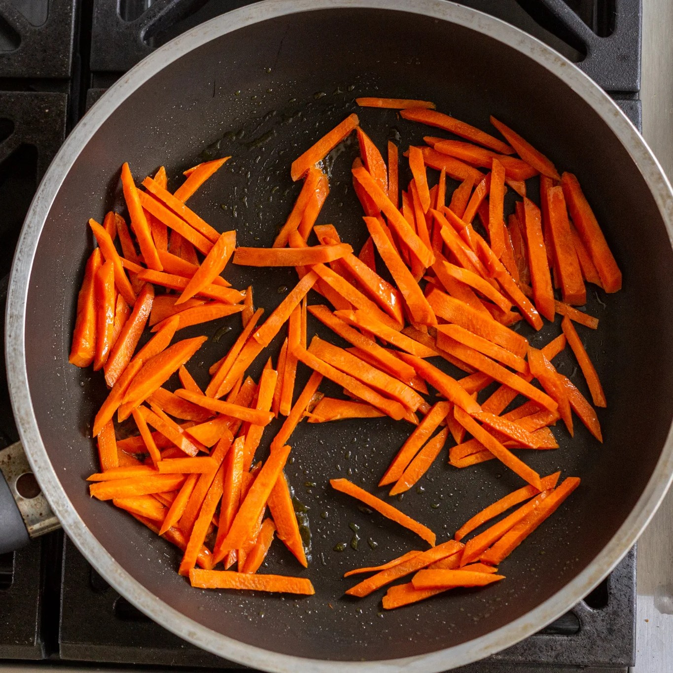 carrots getting browned in a skillet