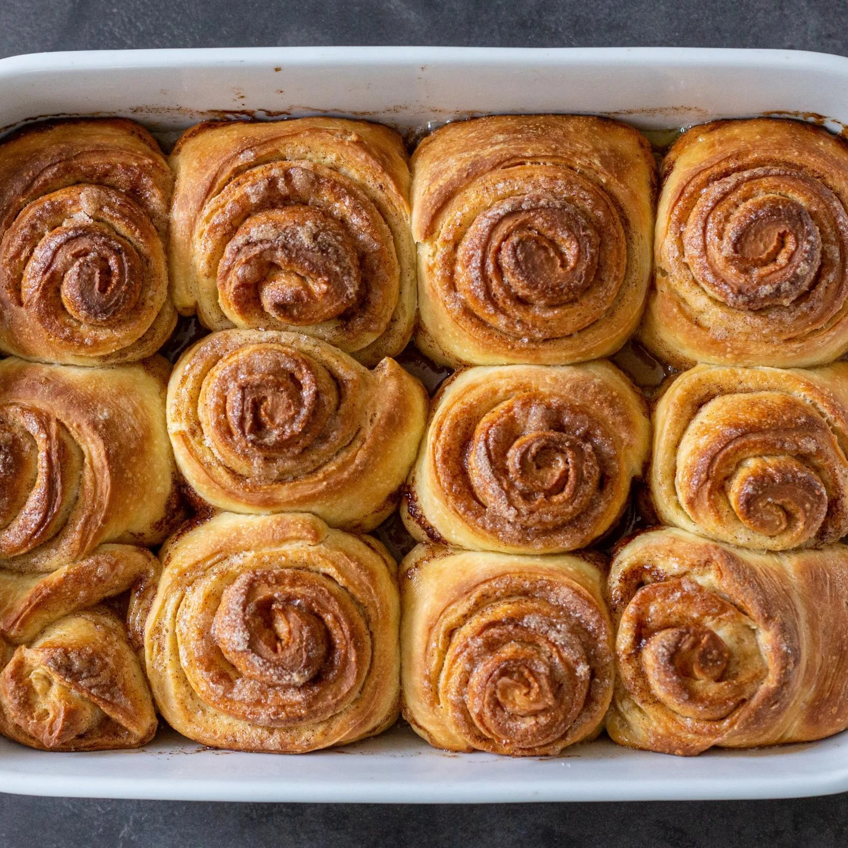 baked cinnamon rolls on a baking sheet