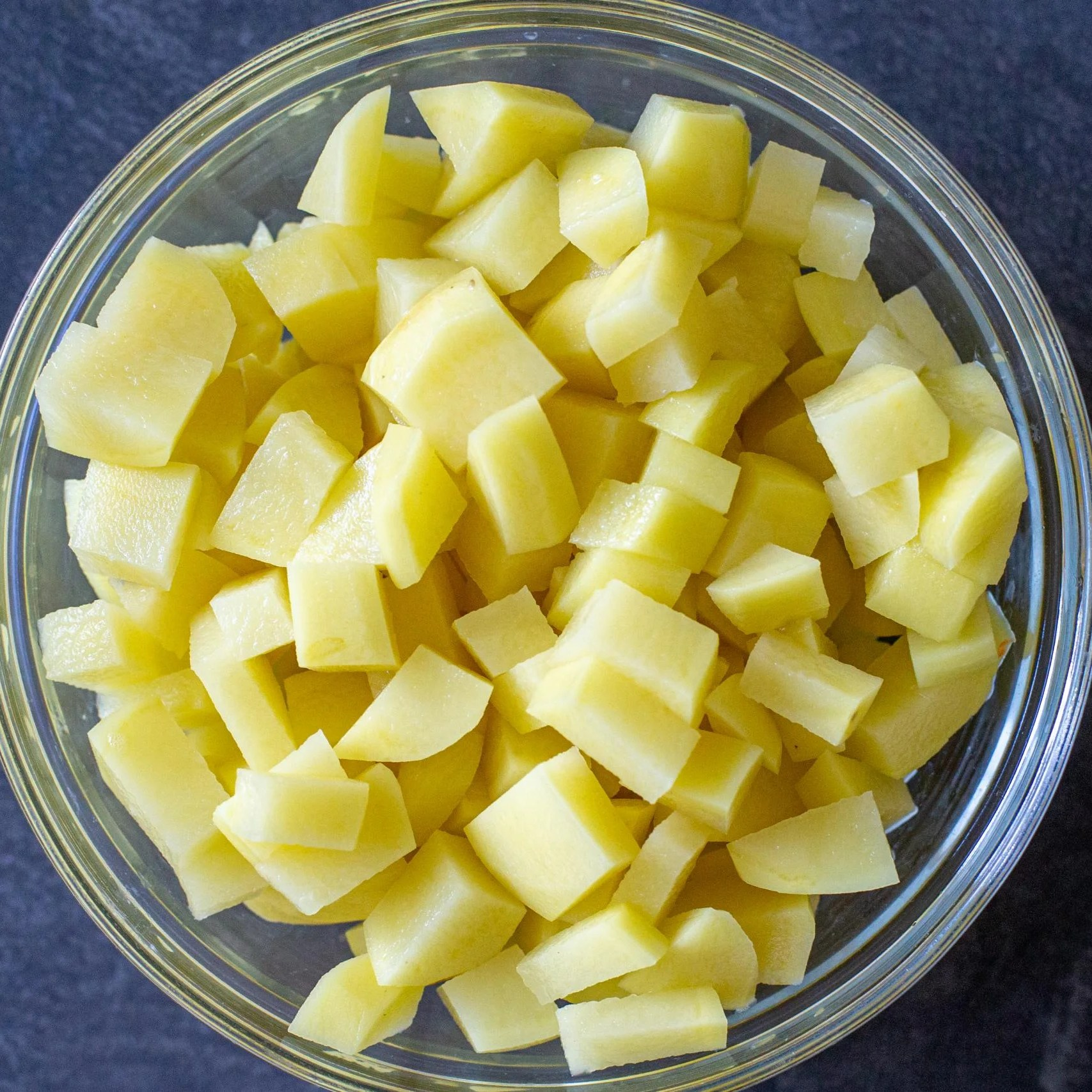 cut up potatoes in a bowl