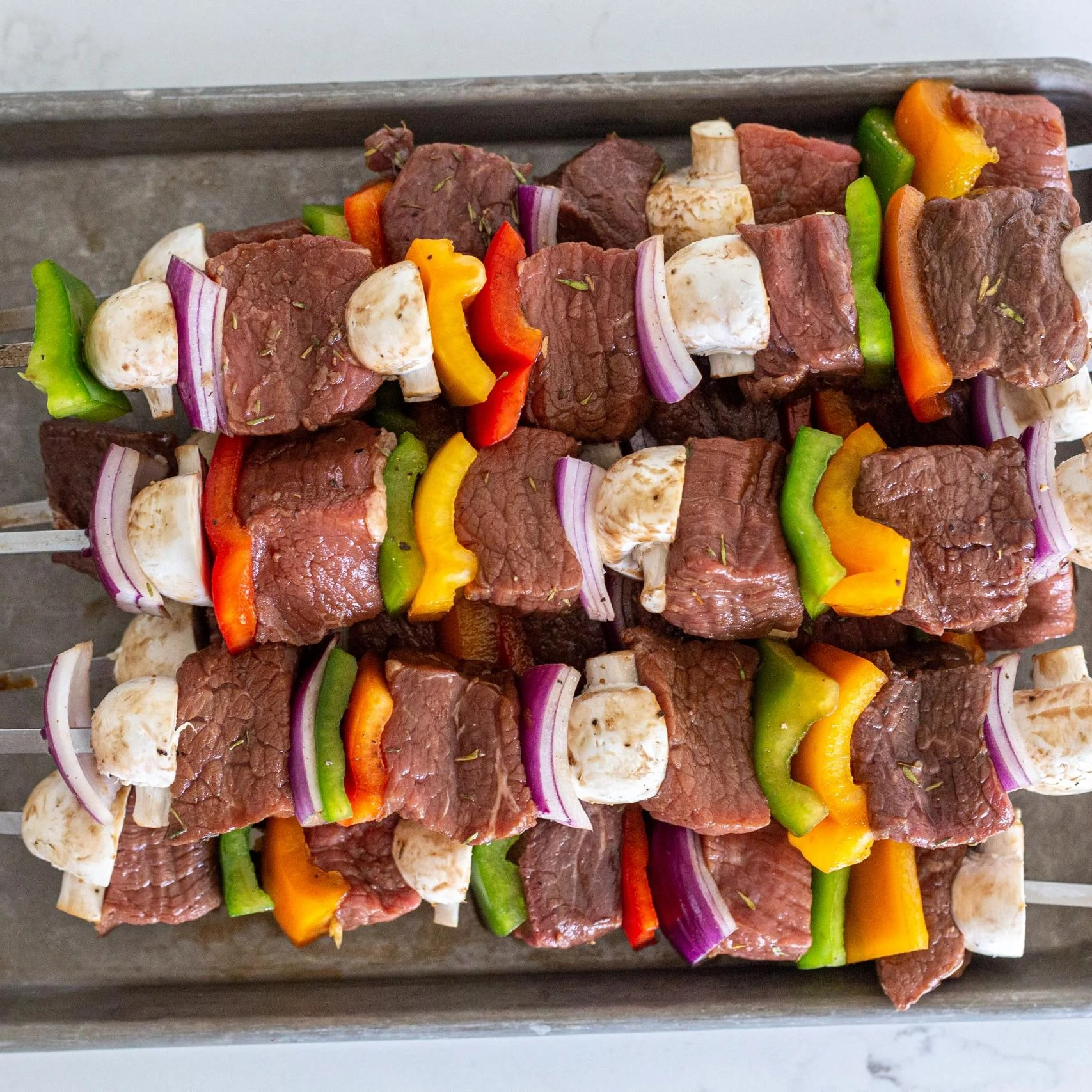 Shish Kabob with beef and veggies on a baking sheet