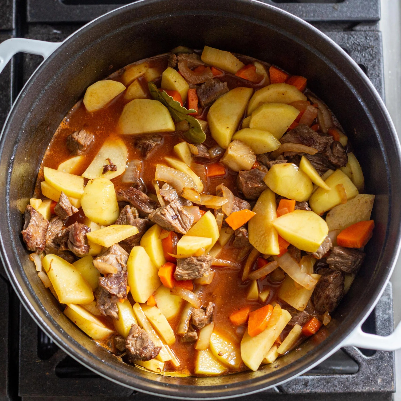 Potatoes and beef with veggies in a pot