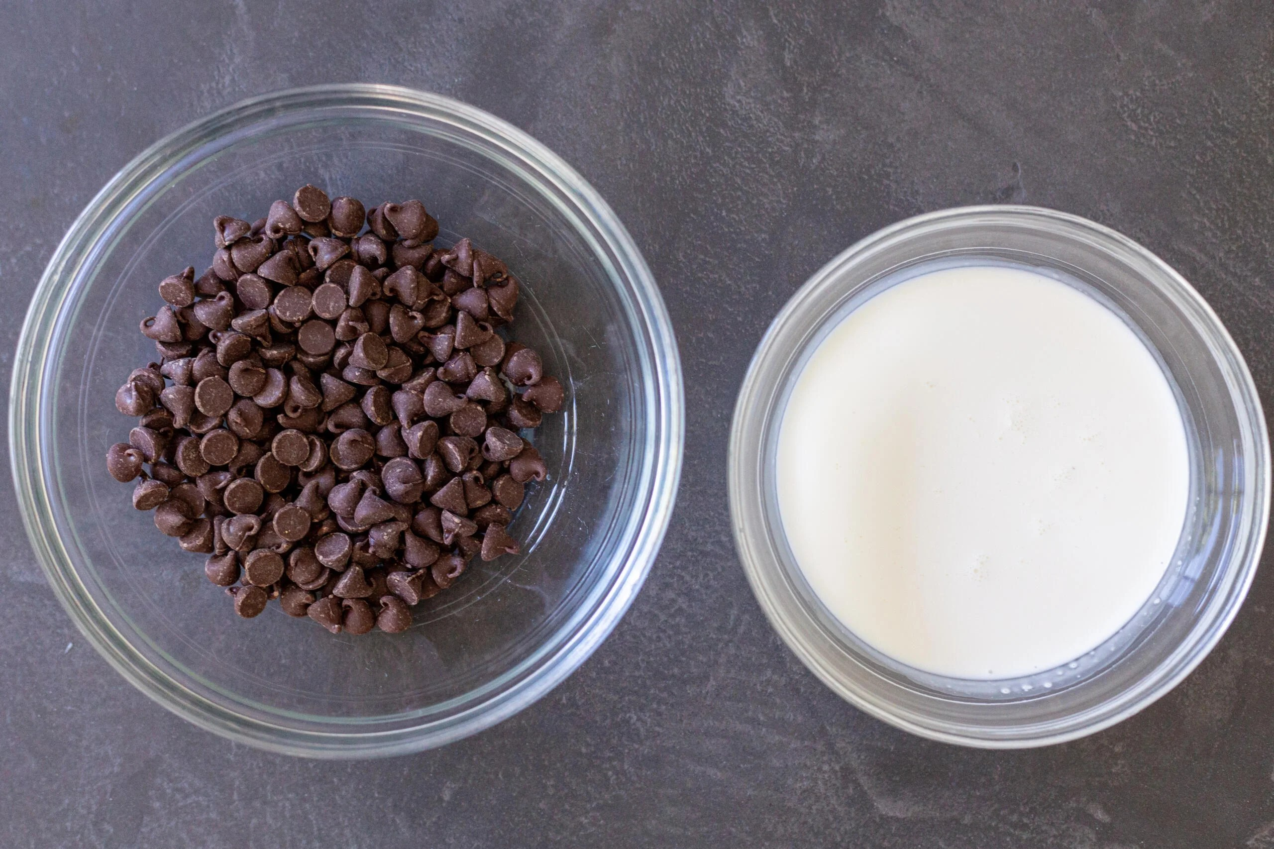 a bowl of chocolate chips and heavy cream