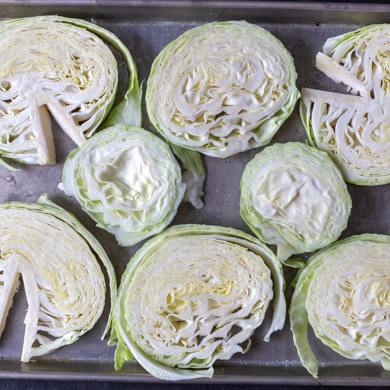 cut cabbage into pieces on a pan