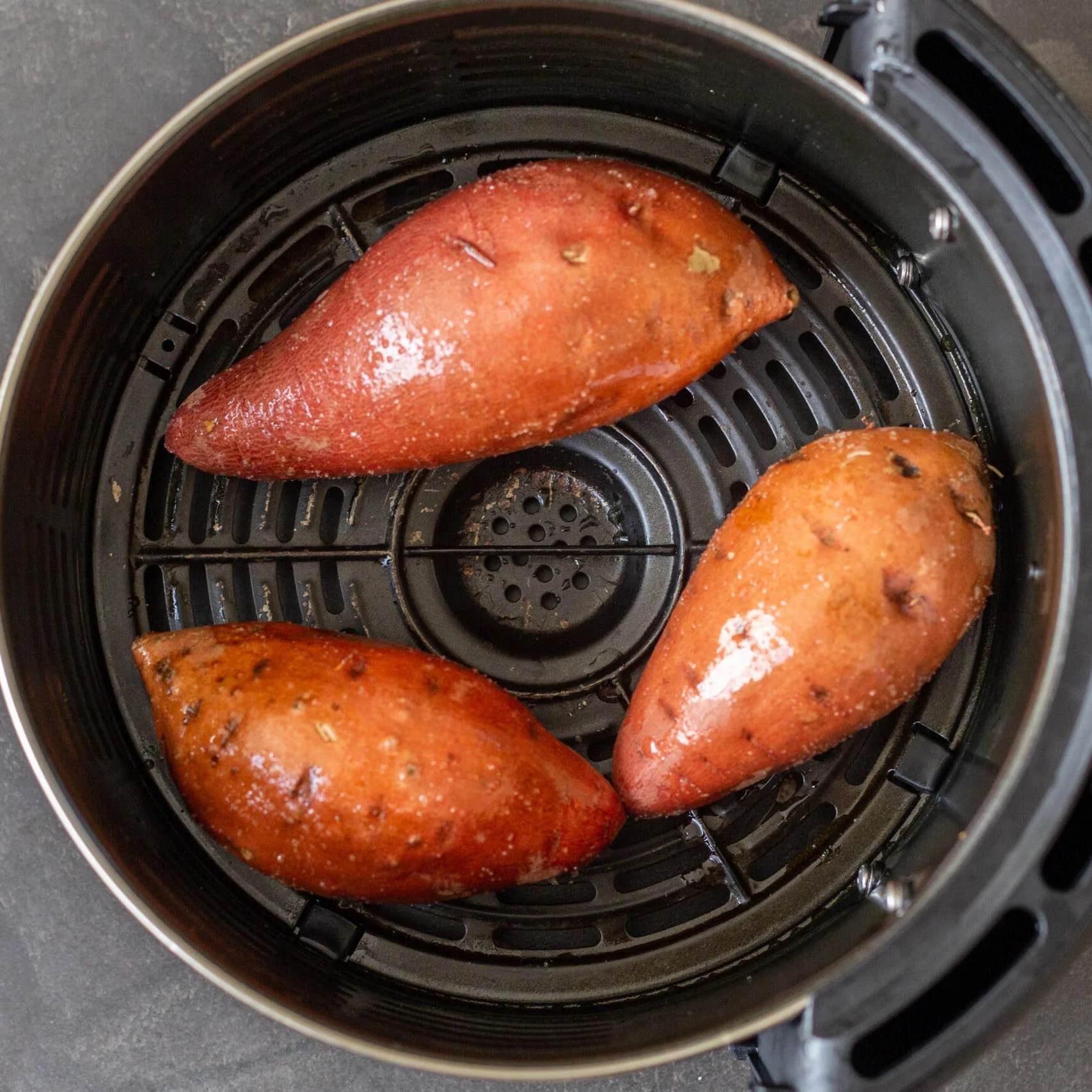 sweet potato in an air fryer basket