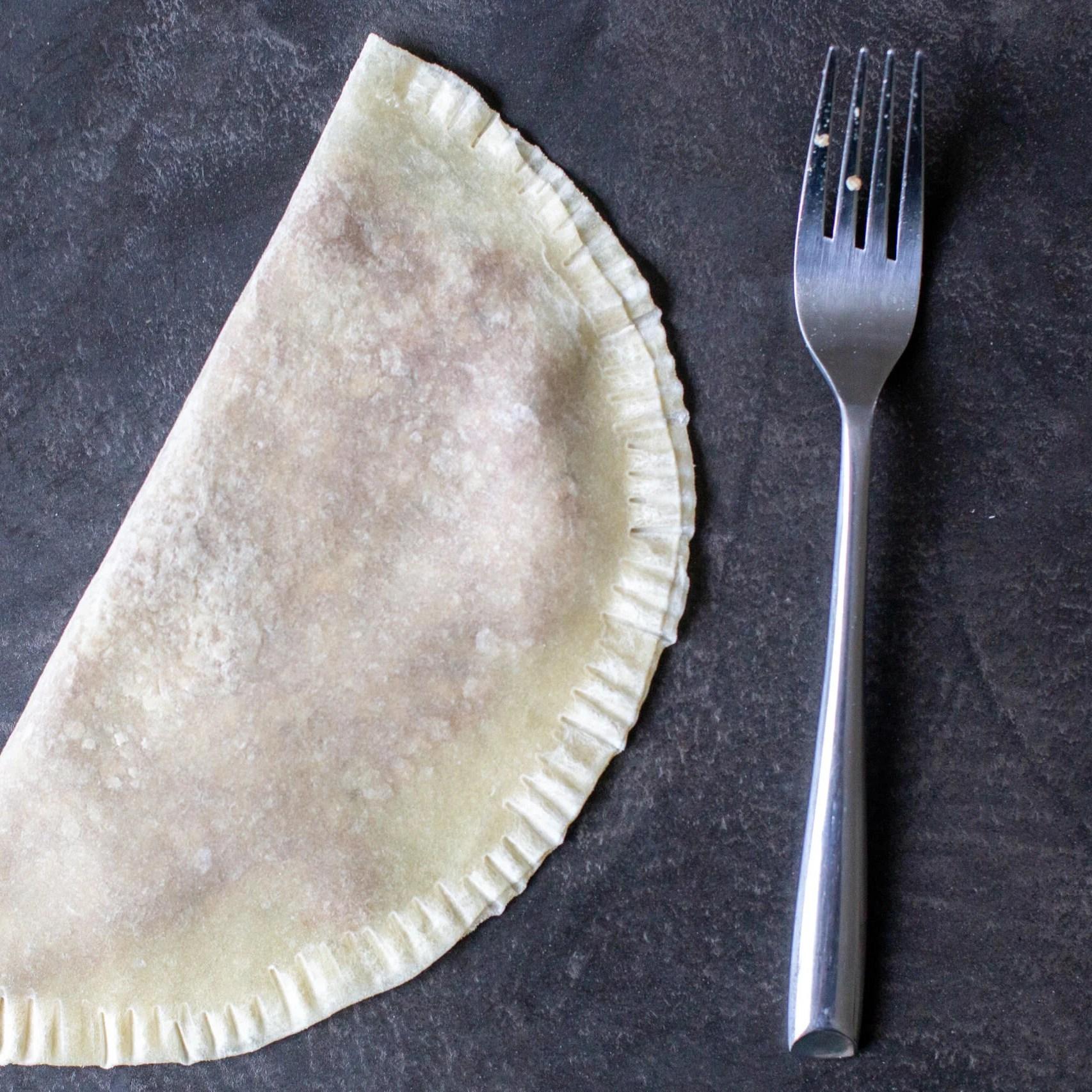 chebureki with pinched edges