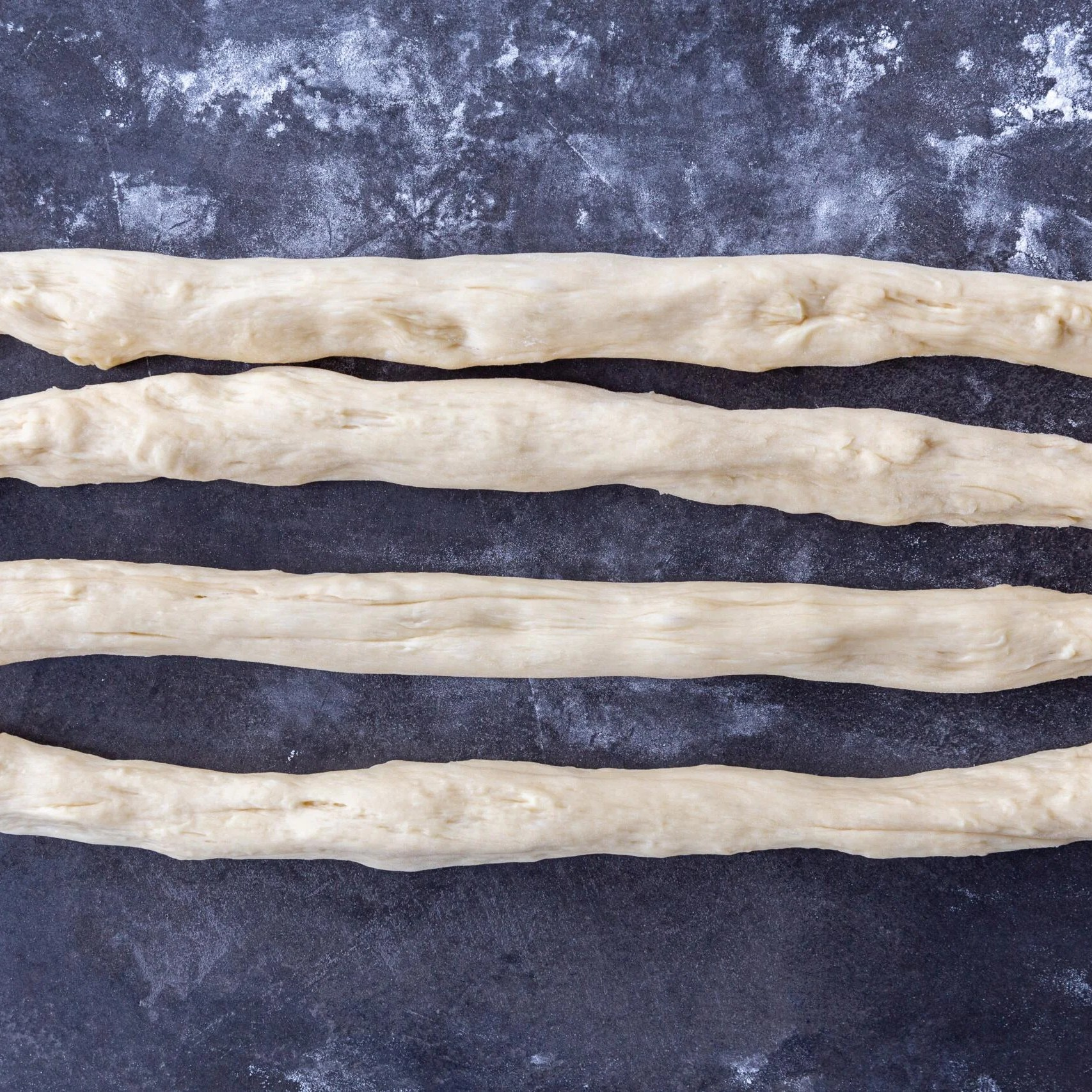 four ropes of Challah Bread dough