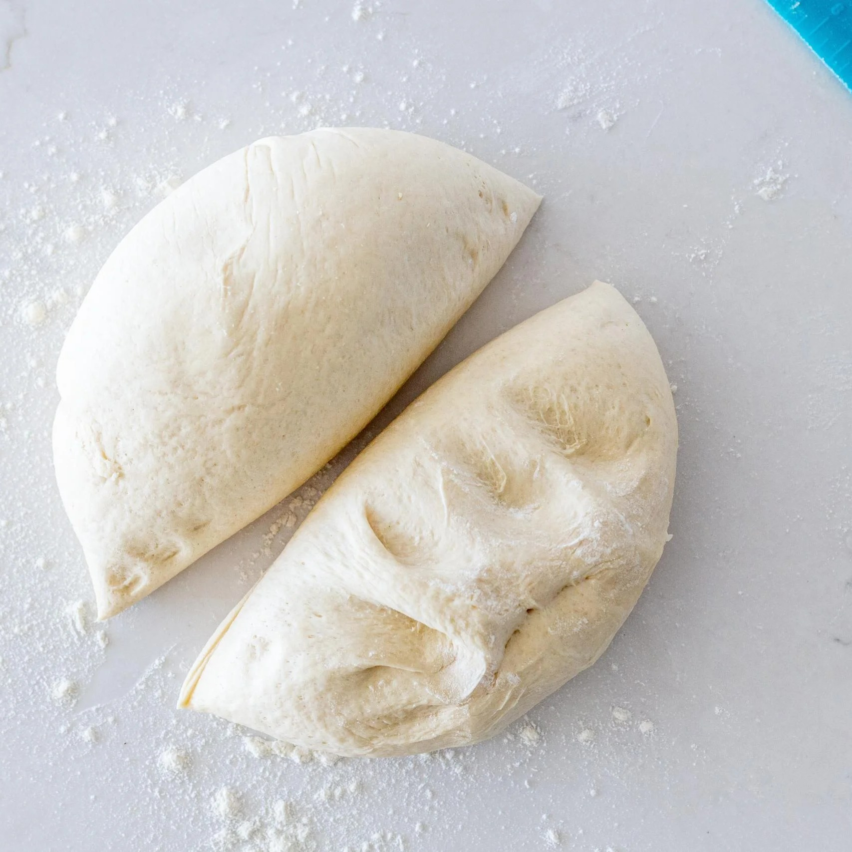 french bread dough divided into two