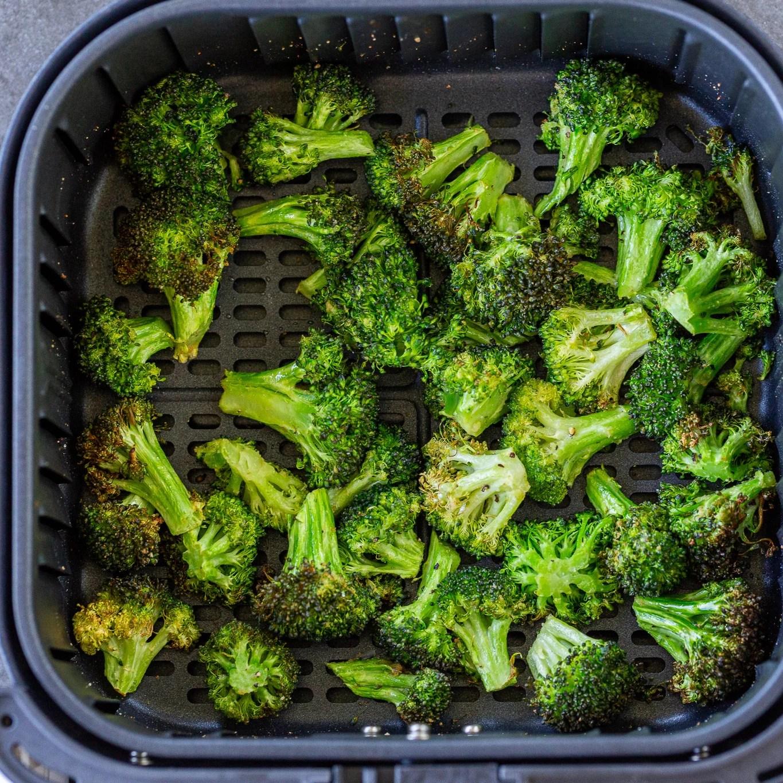 Air fryer broccoli in an air fryer basket