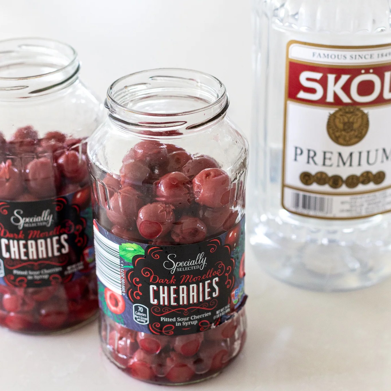 cherries with vodka next to it