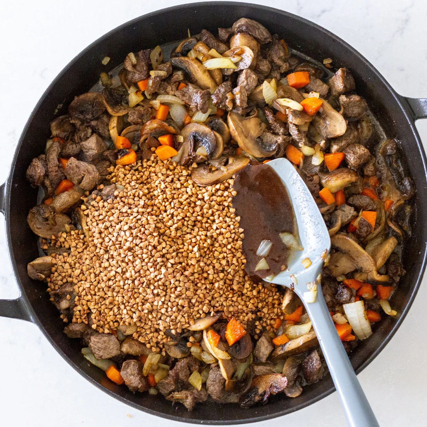 buckwheat added to the ingredients in a pan