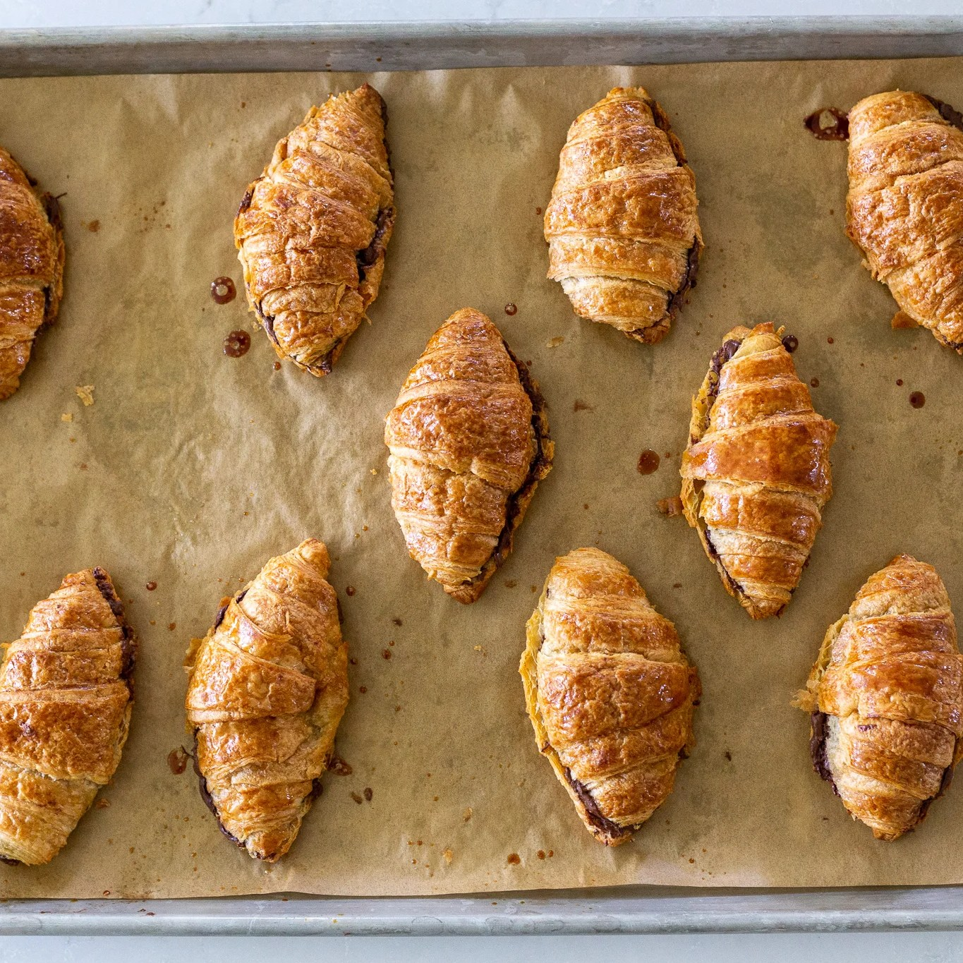 double baked croissants on a baking sheet