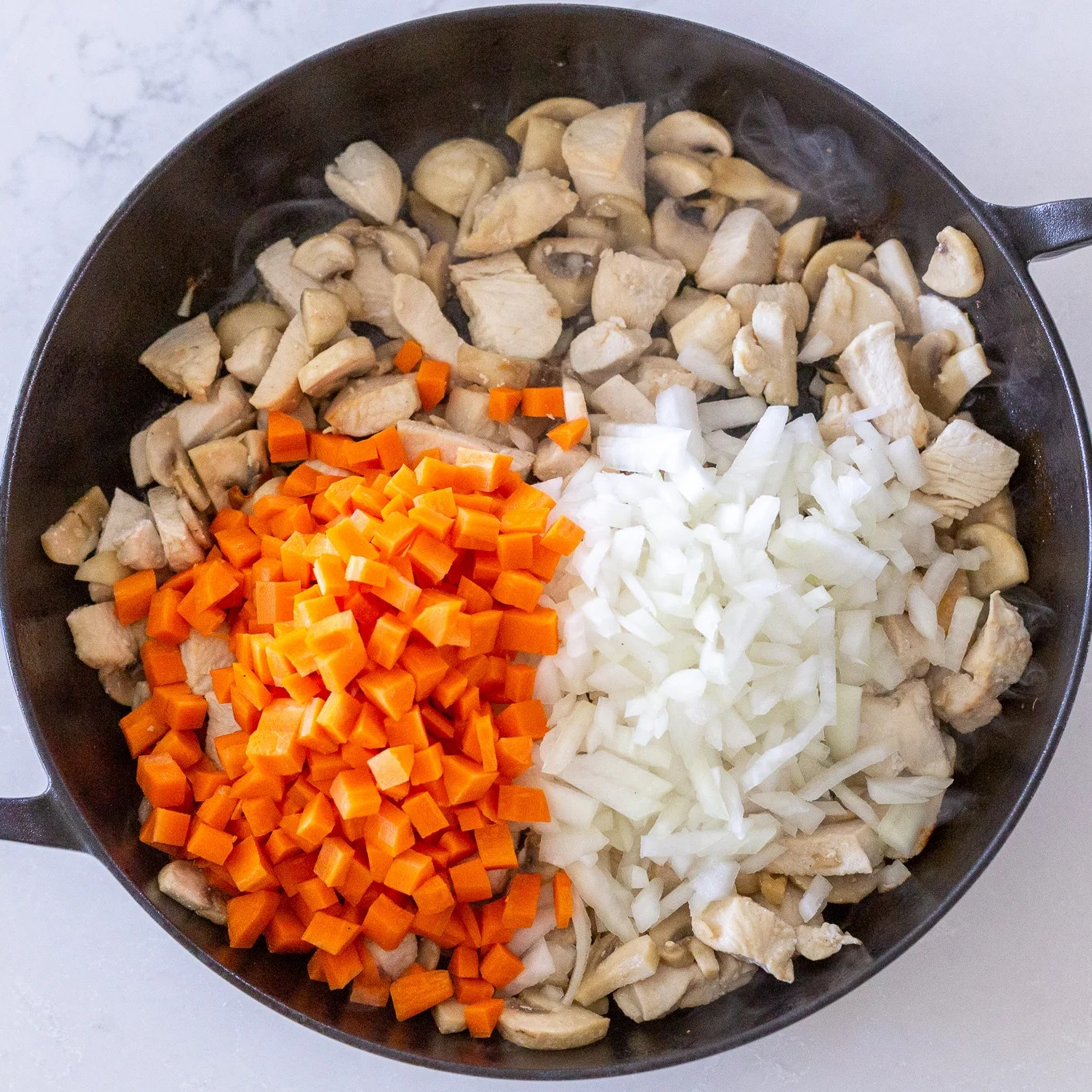 carrots and onion added in a pan