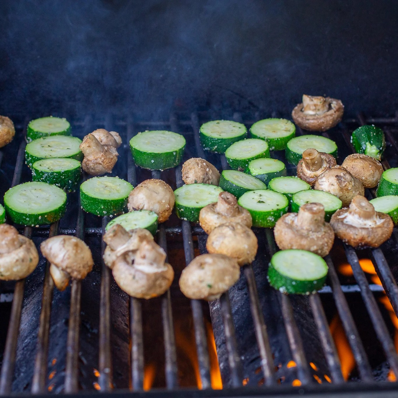 zucchini and mushrooms on a grill